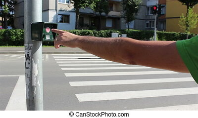 Crossing Street signal Button - A pedestrian crossing with...
