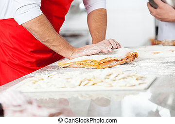 Chef Preparing Dough For Ravioli Pasta In Kitchen -...