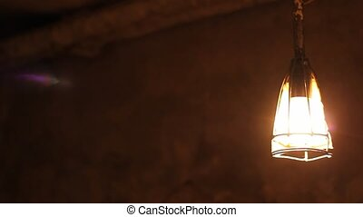 Dark Cellar Lamp Swings - In an dark underground room, the...