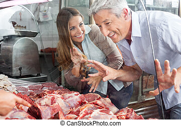 Couple, Buying, Meat, At, Butcher's, Shop