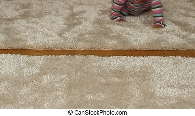 Baby Girl Crawling - Sweet baby girl is fast crawling on the...