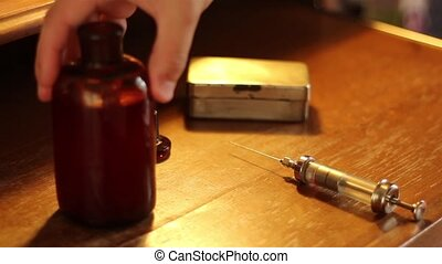 Ancient Preparing of Injection - With antique medical tools,...