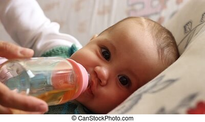 Baby Drinking Tea - Little children is drinking healthy tea,...