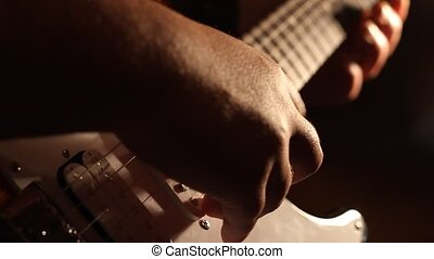Electric Guitar Playing Shadows - Long shadows of the...
