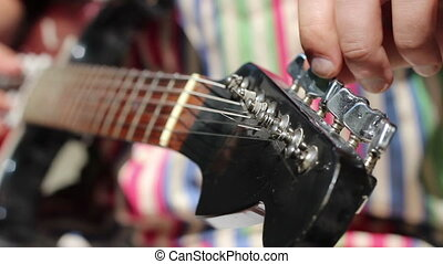 Electric Guitar Manually Tune Up - Musician tunning an...