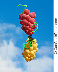Sheaf of balloons in the form of grapes cluster against the...