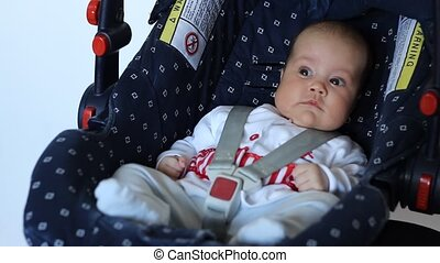 Baby on Child Safety Seat - Little baby is sitting protected...