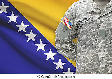 American soldier with flag on background - Bosnia and...