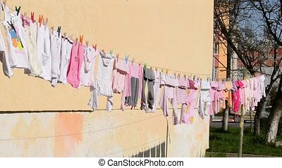 Baby Little Clothes Left to Dry - Baby coloured little...