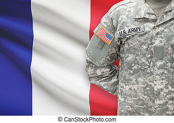 American soldier with flag on background - France