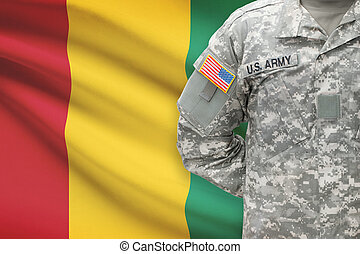 American soldier with flag on background - Republic of Guinea
