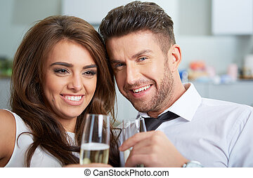 Young couple with champagne glasses - a young couple with...