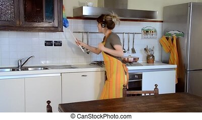 young woman cleaning and dancing