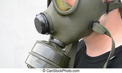 Gas Mask Side View - Lateral view of a green rubber gas...