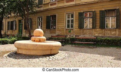 Fountain and Benches in a Baroque G - A marble fountain and...