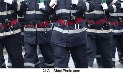 Firemen Equipment - Men of the fire brigade unit with belts,...