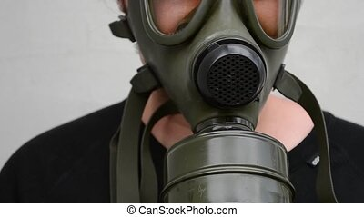 "Gas Mask On - ""A military gas mask mounted on face. Exaust..."