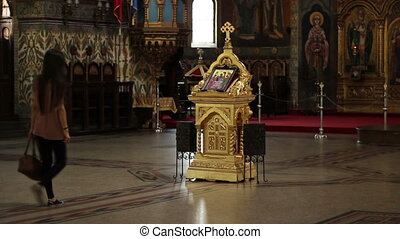 Girl Worshiping in Orthodox Church - A young girl goes to...