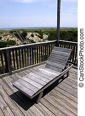 A deck chair sitting on the balcony in the Outer Banks,...
