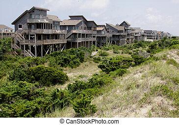Row Outer Banks Beach Houses - A row of beach houses on the...