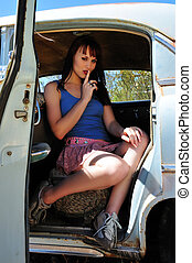 backset woman - Attractive young woman in the back seat of...