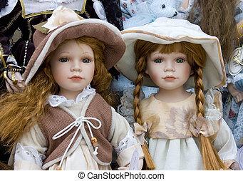 Delicate Dolls - Two pretty dolls on display