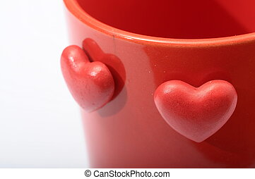 Red heart on red mug for coffe with love