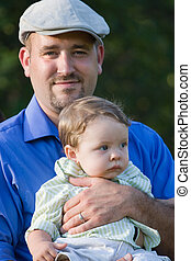Proud Young Dad - A proud young father holding his baby boy...