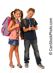 choolboy and schoolgirl with schoolbags isolated over white...