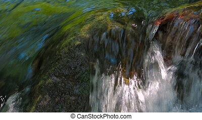 Stream Water Rapidly Falling. Close-up shot with sound.