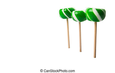 Peppermint Candy - Green swirl peppermint candies over white...