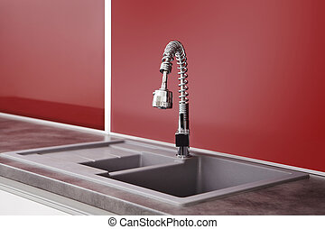 Sink in red kitchen - Modern interior and details in...
