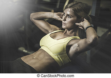 beautiful athletic woman working ab intervals