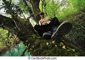 man relaxing outdoor - man outdoor in nature relaxing
