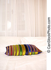 Colored pillow on the bed - Modern interior and details in...