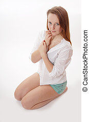 coy girl - young woman playing coy wearing hot pants and...