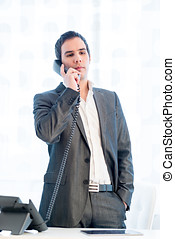 Stylish businessman standing talking on a phone - Stylish...