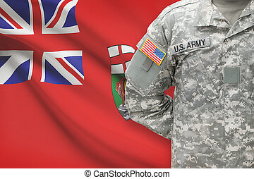 American soldier with Canadian province flag on background -...