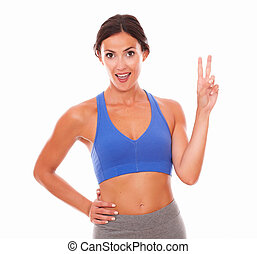 Fit lovely woman looking positively cheerful