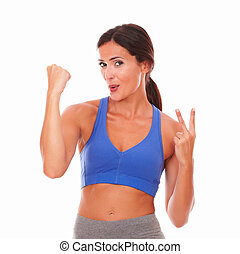 Sporty young woman feeling victoriously excited