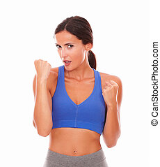 Sporty cheerful lady with happy gesture