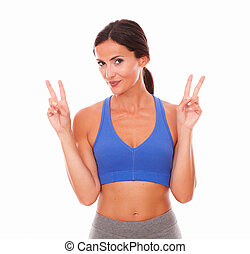 Sporty lovely woman standing fingers up