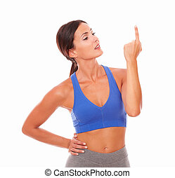 Friendly adult woman exercising pointing up