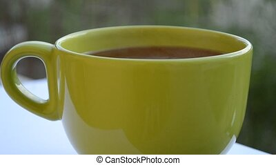 Hot Green Cup of Tea - A hot steaming green cup of tea,...