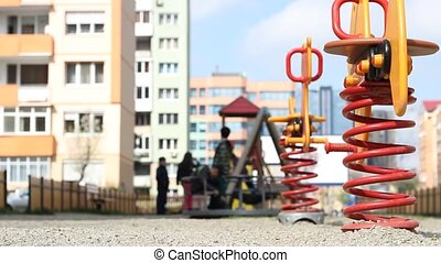 Kids Playing at Neighborhood Playgr - Lot of children are...