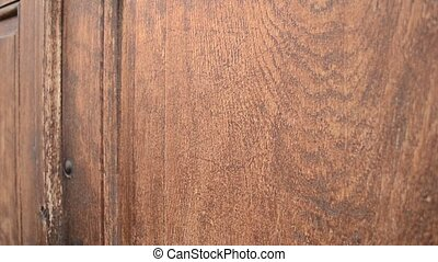 Knocking on Wooden Door - Knocking on massive oak wood door,...