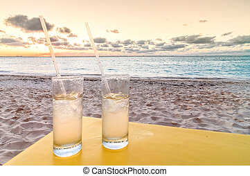 Cocktails on tropical beach at sunset - vacations concept...