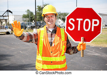 Construction Worker with Stop Sign - Friendly construction...