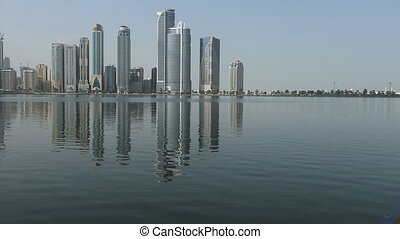 city view of Sharjah - reflection on the lake with clouds...