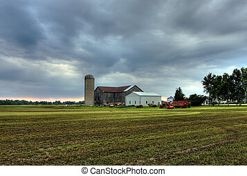 farmhouse in Onatrio against dramatic sky